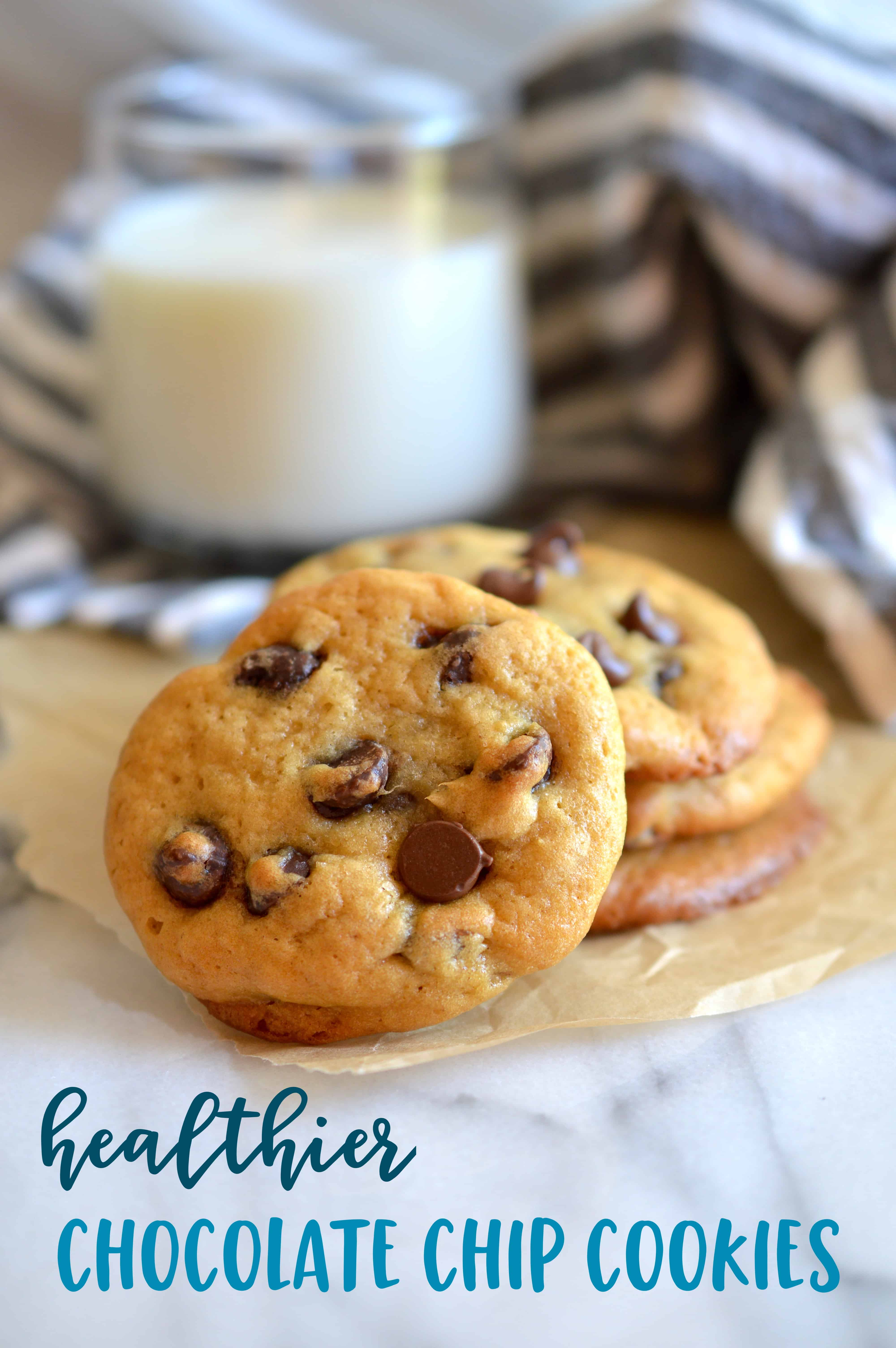 Lighten up the classic chocolate chip cookie by using less butter. Super soft and filled with chocolate chips, these Healthier Greek Yogurt Chocolate Chip Cookies are a crowd favorite! #chocolatechip #cookies #chocolatechipcookies #baking #dessert #chocolate