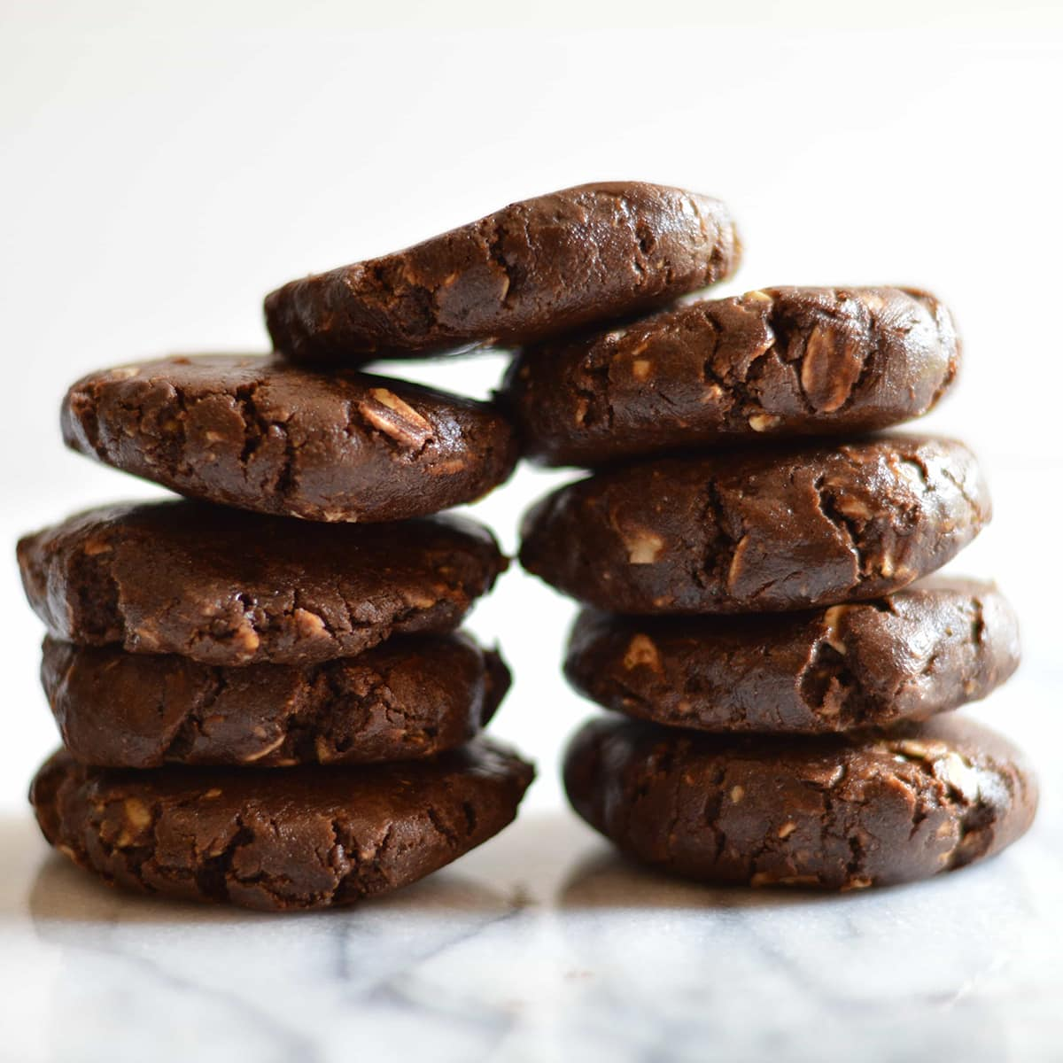 Chocolate No Bake Shakeology Cookies on a marble surface.
