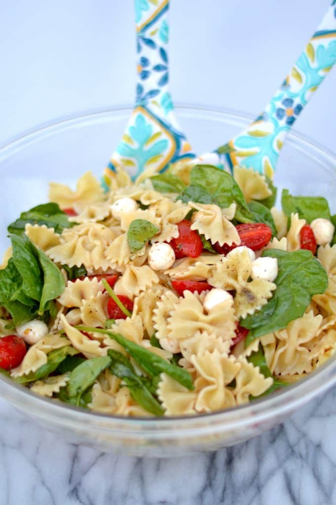 Fresh Spinach, Tomato and Mozzarella Pasta Salad is the perfect tasty side dish for any gathering!