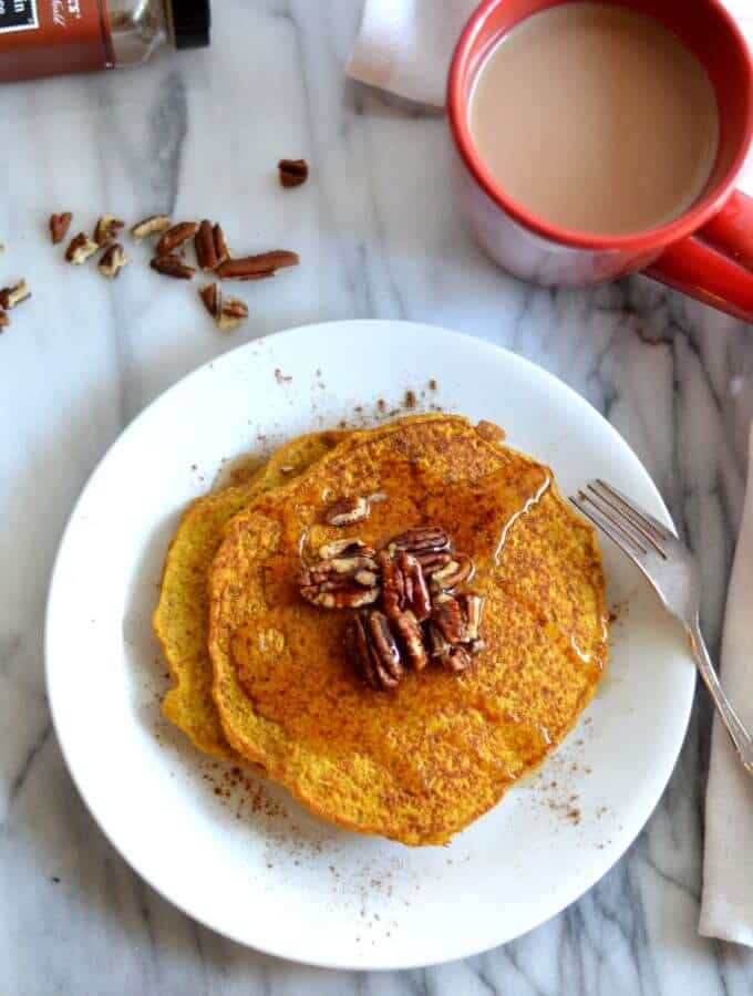Healthier pumpkin pancakes are made gluten free and lightened up a bit by using better-for-you ingredients.