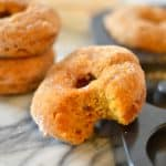 Healthier Baked Pumpkin Donuts are a delicious way to enjoy donuts without frying. This recipe uses no butter or oil, so it's perfect as a breakfast treat!