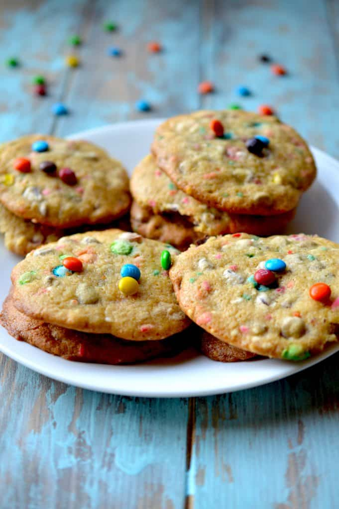 These soft baked cookies are filled with M&Ms candies and are sure to fly off the plate. They are irresistibly fluffy and packed with chocolate!