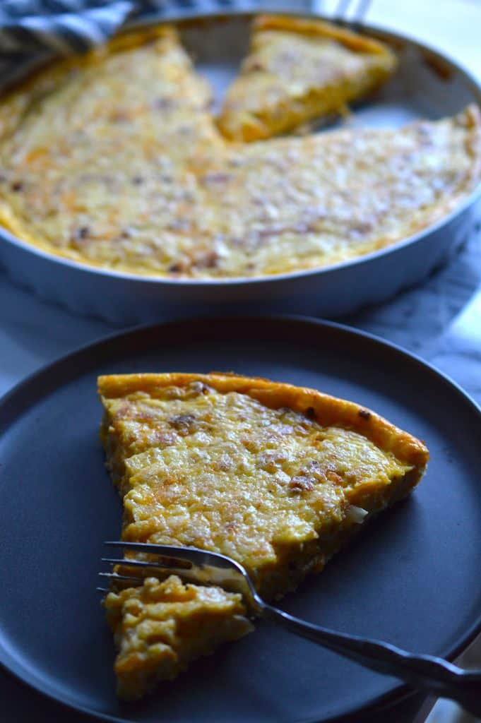 This Cheddar, Bacon & Onion Quiche (aka Quiche Lorraine) is sure to fly off the table during breakfast or brunch. Perfect for feeding a crowd!