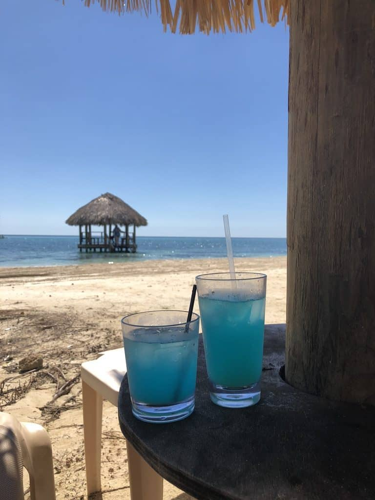 Blue cocktails with an ocean view.