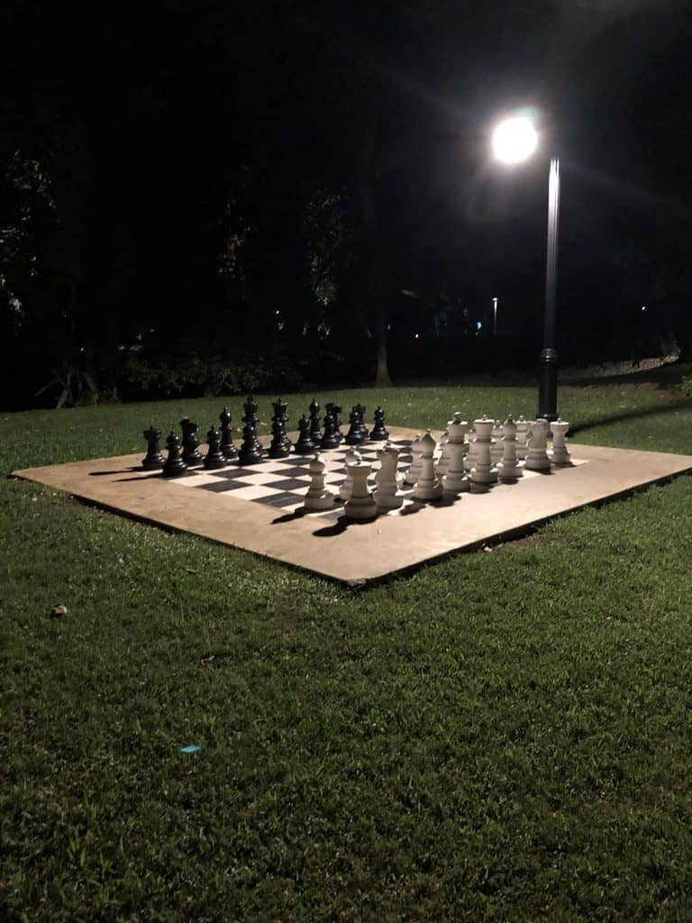 Giant chess board at night.