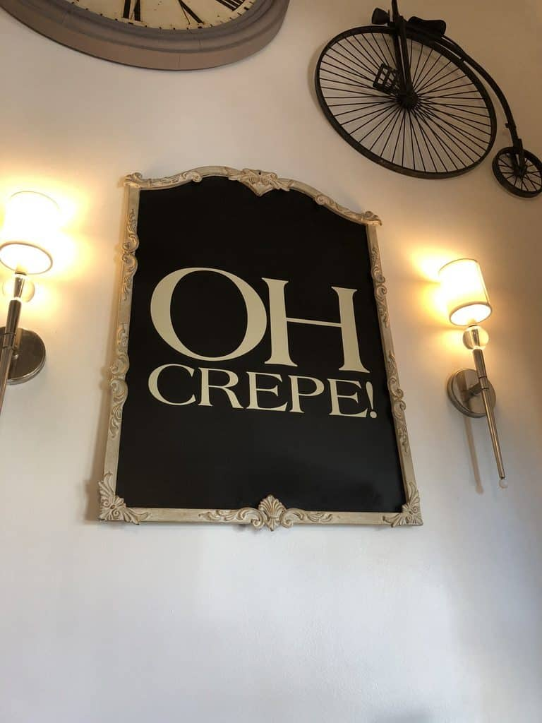 "A witty sign that reads ""oh crepe""."