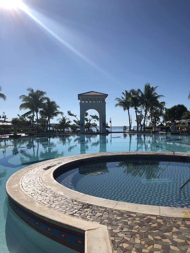 An early morning view of the pool with a swim up bar.