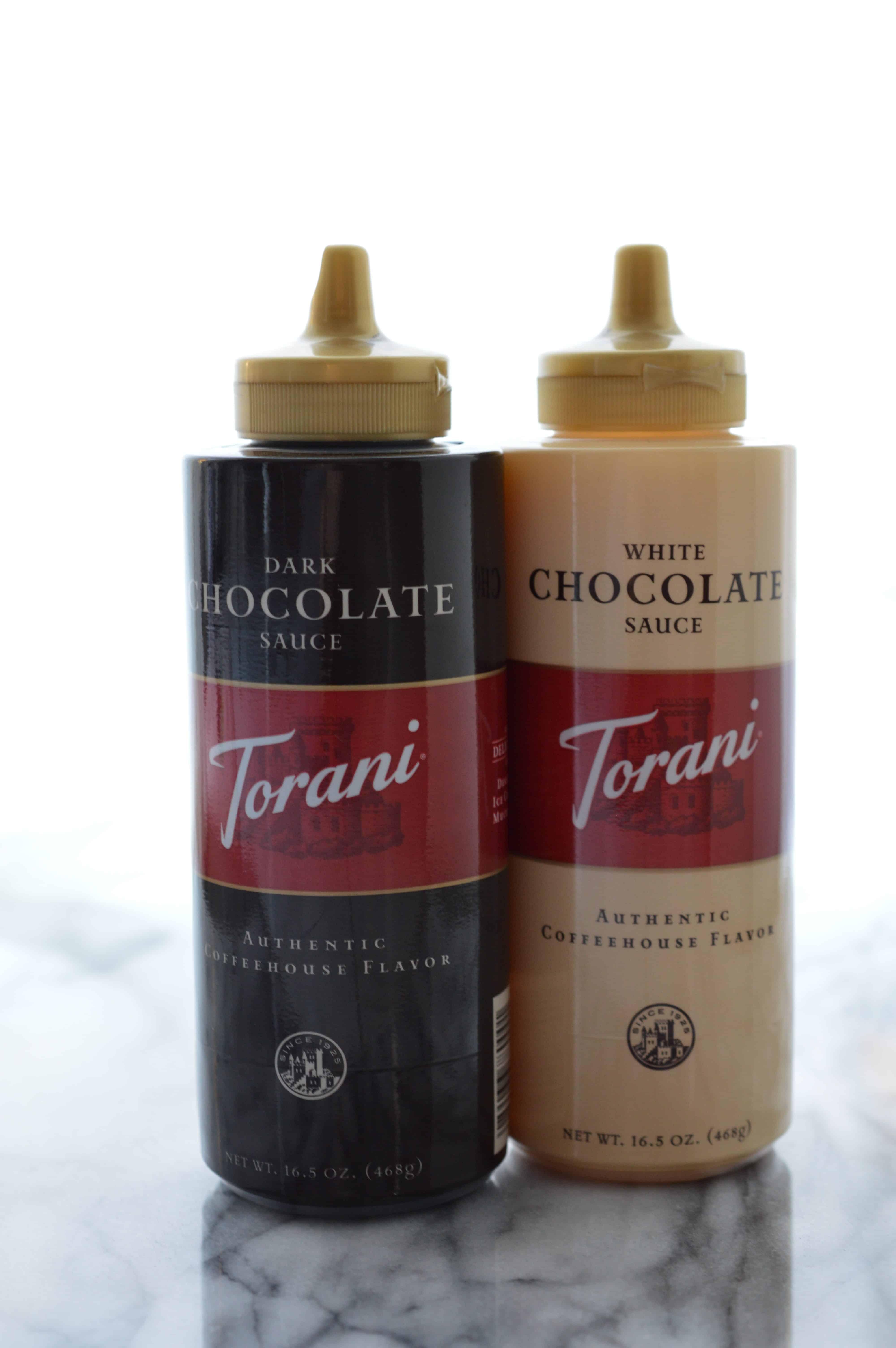 Torani Dark and White Chocolate Sauces in bottles.