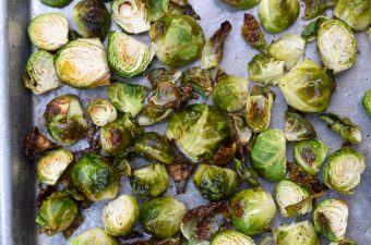 Roasted Brussels sprouts on a baking sheet.