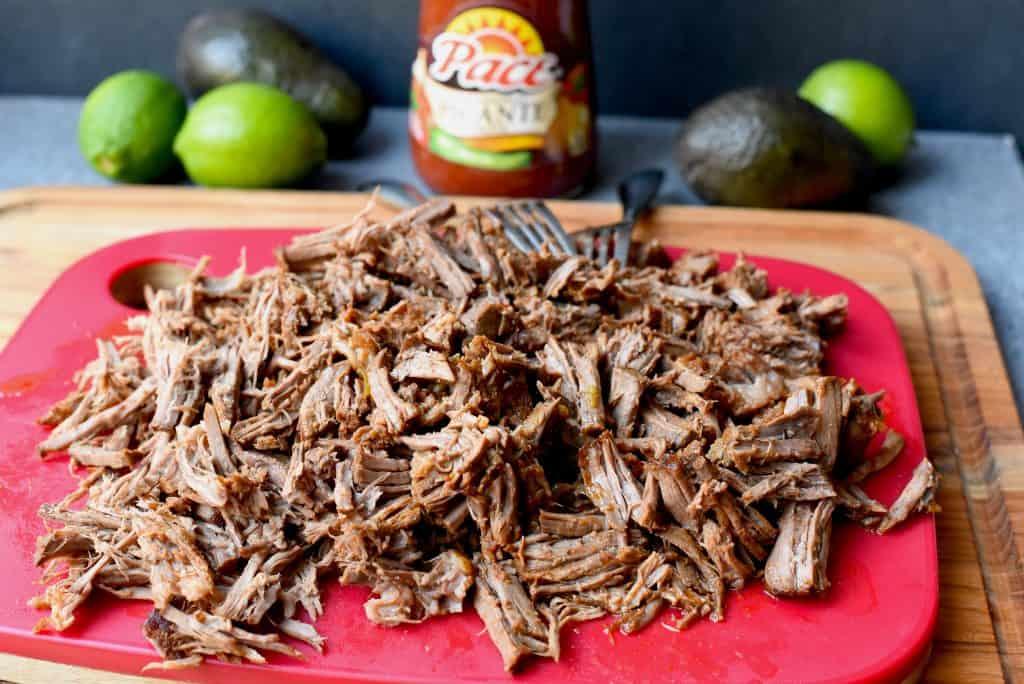 Shredded beef on a cutting board