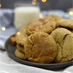 Caramel snickerdoodle cookies on a plate with glass of milk in the background