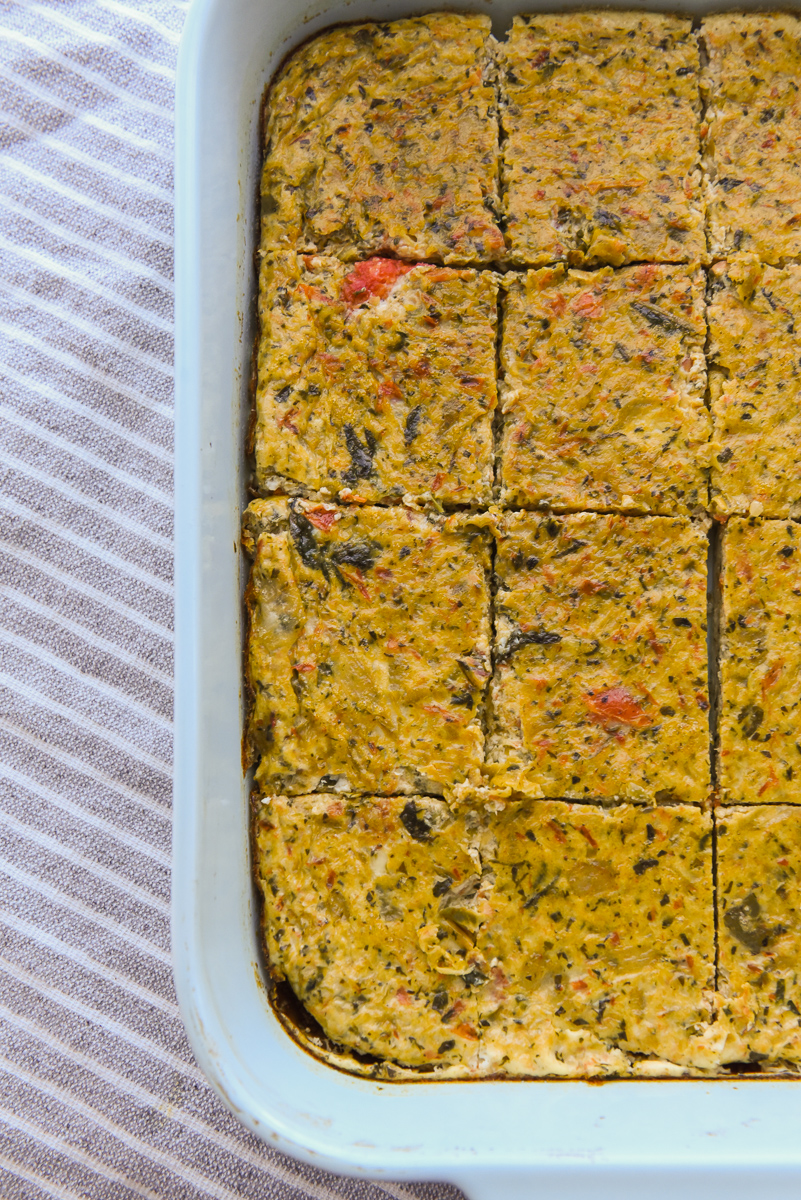 Egg White Frittata Bake sliced in a light blue casserole dish