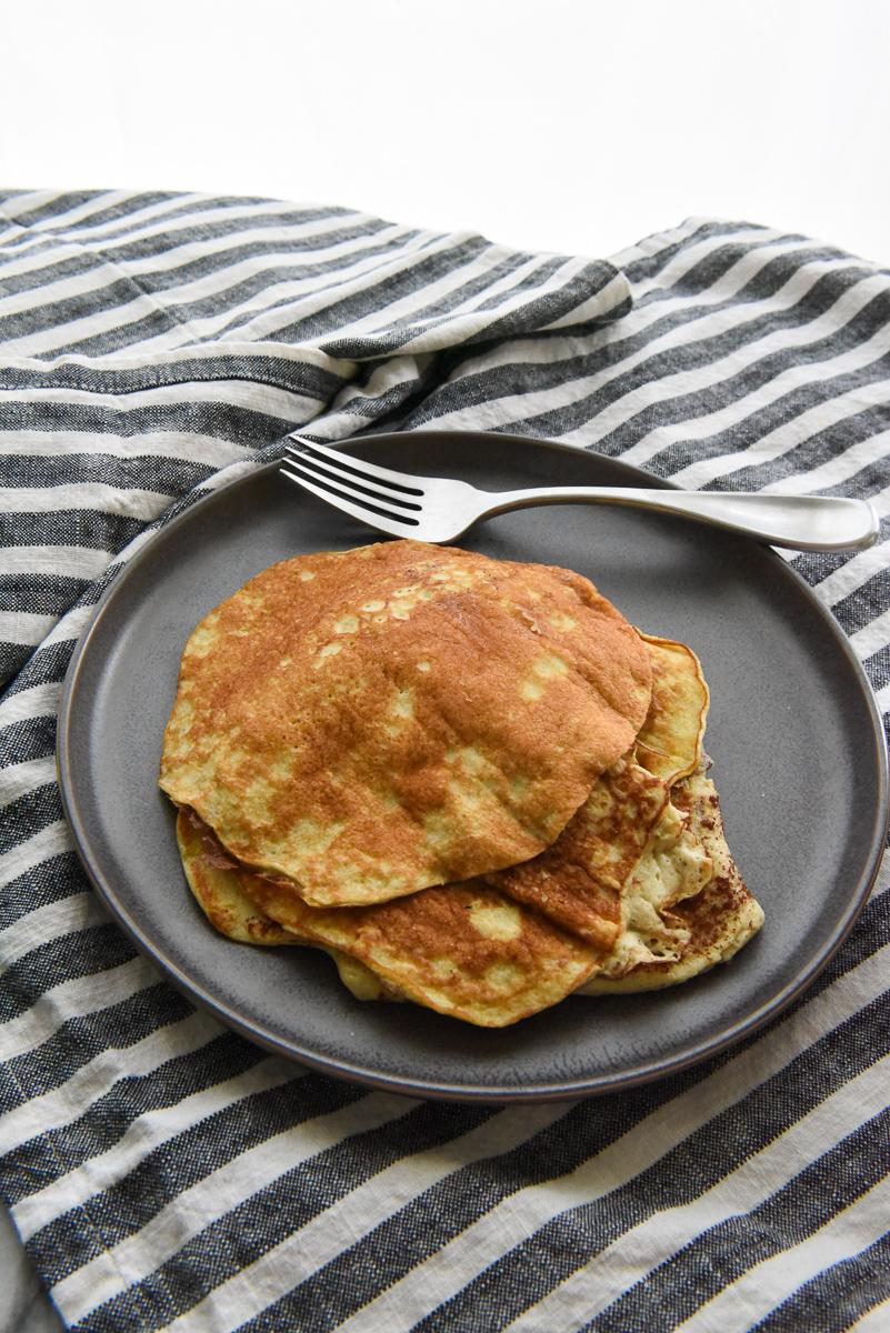 Healthy banana pancakes on a gray plate.