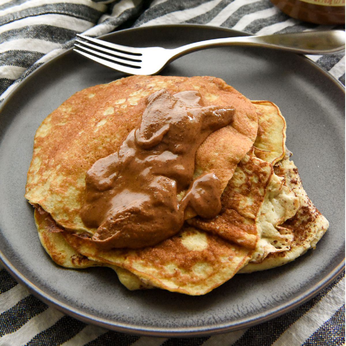Healthy Banana Pancakes on a plate with a dollop of almond butter